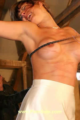 Extreme bullwhipping of Gina's sweet tits and back
