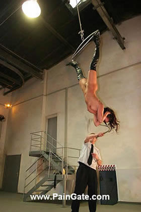 The twins were suspended to a bar for an ultimate whipping punishment!